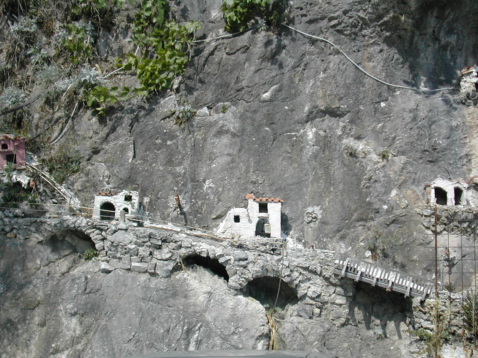 Miniature houses built into the cliff face in Praiano