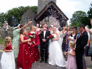 Throwing confetti over the bride and groom